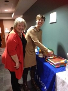 Cake cutting with ICDR Executives Deb Cameron and Stephanie Nixon